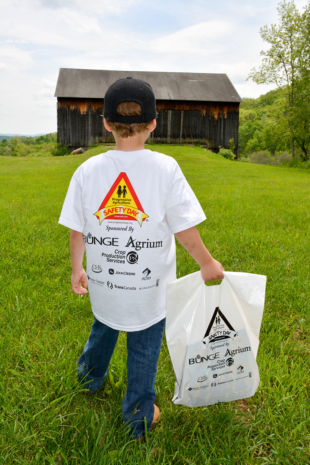 child standing in an open field at Progressive Agriculture Safety Day