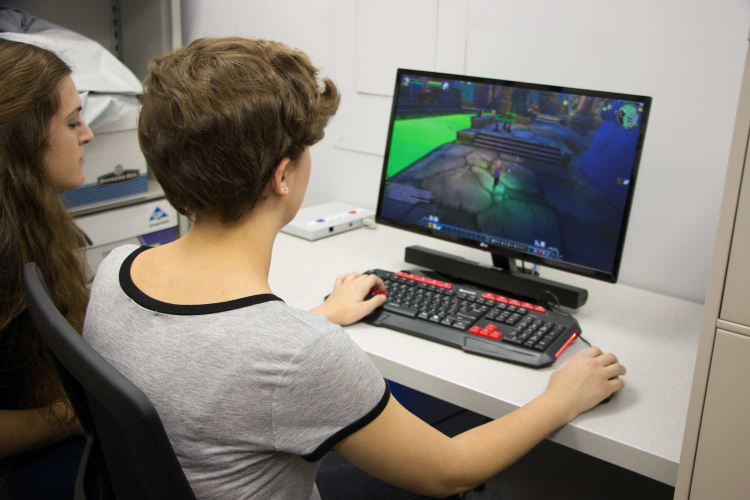 student playing computer games in the game lab